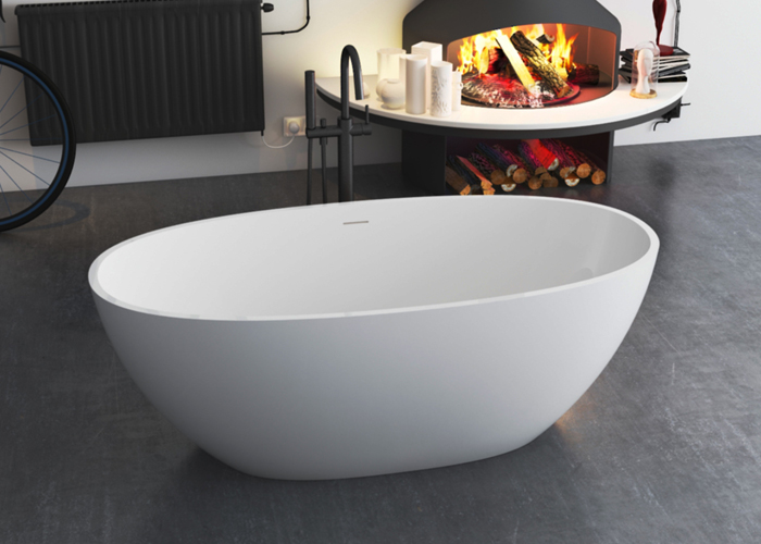 Why hotels tend to use solid surface bathtubs?